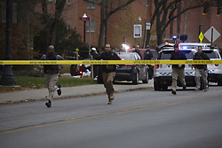 November 28, 2016 - Columbus, Ohio, USA - Officers run away from Watts Hall during reports of an active shooter on Ohio State's campus in Columbus, Ohio. Law enforcement sources say nine people have been transported to hospitals and a suspect has been killed. (Credit Image: © Tom Dodge/TNS via ZUMA Wire)