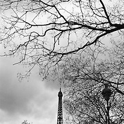 A couple walk in the The Parc du Champ de Mars with the Eiffel Tower in the distance. The Eiffel Tower in Paris, France, Nicknamed La dame de fer, the iron lady,  is located on the Champ de Mars in Paris. Built in 1889, it has become both a global icon of France and one of the most recognisable structures in the world. The tower is the tallest building in Parisand the most-visited paid monument in the world; millions of people ascend it every year. Named for its designer, engineer Gustave Eiffel, the tower was built as the entrance arch to the 1889 World's Fair..The tower stands 324 metres (1,063 ft) tall, about the same height as an 81-storey building.  Paris, France. 28th February 2011. Photo Tim Clayton