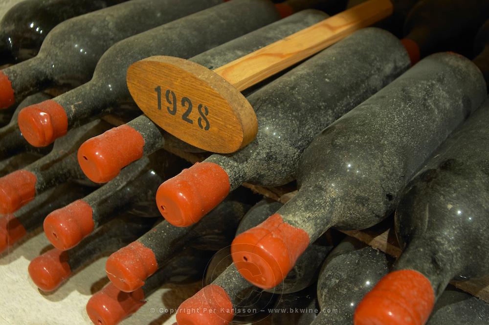 Bottles aging in the cellar. 1928. Chateau Grand Corbin Despagne, Saint Emilion Bordeaux France