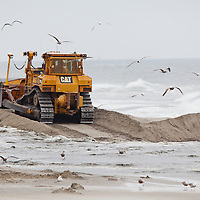 Heavy equipment moves sand on the beach from the dredging vessel Glenn Edwards that arrived in Loch Arbour to pump sand onto the beach that is part of a $38 million beach nourishment project that affects a stretch of shoreline from southern Deal to Loch Arbour in Monmouth County New Jersey. The project including pumping in of sand as a method to protect the shoreline as well as notching of jetties to prevent sand from eroding too quickly has begun.