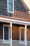 Traditional cedar shingles home with front stoop in Newport, Rhode Island, USA