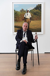 © Licensed to London News Pictures. 10/04/2019. London, UK. American photographer William Eggleston poses next to a photograph titled. The work is showing as part of his exhibition titled 2 1/2 series showing at the David Zwirner gallery. Photo credit: Ray Tang/LNP