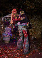 Bruce Perkins with his side kick Nob the hobgoblin has been greeting visitors to his Haunted House in Hill for the past 26 years.  (Karen Bobotas/for the Laconia Daily Sun)