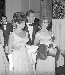 Left, JOAN COLLINS at the Monte Carlo red Cross Ball in 1961