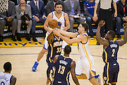 Golden State Warriors guard Klay Thompson (11) takes the ball to the basket against the Indiana Pacers at Oracle Arena in Oakland, Calif., on December 5, 2016. (Stan Olszewski/Special to S.F. Examiner)