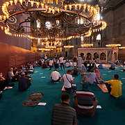 People pray in Hagia Sophia mosque, Istanbul, Turkey