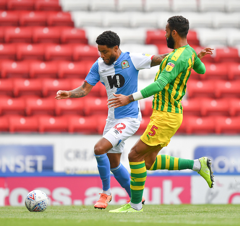 Blackburn Rovers' Dominic Samuel battles with West Bromwich Albion's Kyle Bartley<br /> <br /> Photographer Dave Howarth/CameraSport<br /> <br /> The EFL Sky Bet Championship - Blackburn Rovers v West Bromwich Albion - Saturday 11th July 2020 - Ewood Park - Blackburn <br /> <br /> World Copyright © 2020 CameraSport. All rights reserved. 43 Linden Ave. Countesthorpe. Leicester. England. LE8 5PG - Tel: +44 (0) 116 277 4147 - admin@camerasport.com - www.camerasport.com