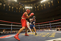 © Licensed to London News Pictures. London, UK  07/10/2011. FELIX MAGALLANEZ, US Marine Coorp (Left) Vs MARK TRUSLOVE , Army (right). Members of the UK and US Armed Forces take part in the Royal Albert Hall cup boxing match. This is the first time a boxing event has taken place in the historic venue following a court ruling banning the use of the hall for boxing and wrestling in 1999. The Court of Appeal subsequently overturned the decision earlier this year. The venue has hosted some of the greatest names in British boxing including Sir Henry Cooper, Frank Bruno, Lennox Lewis and Prince Naseem Hamed. Photo credit: Ben Cawthra/LNP