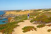Woman walking Rota Vicentina, near Zambujeira do Mar, Alentejo Littoral, Portugal, Southern Europe