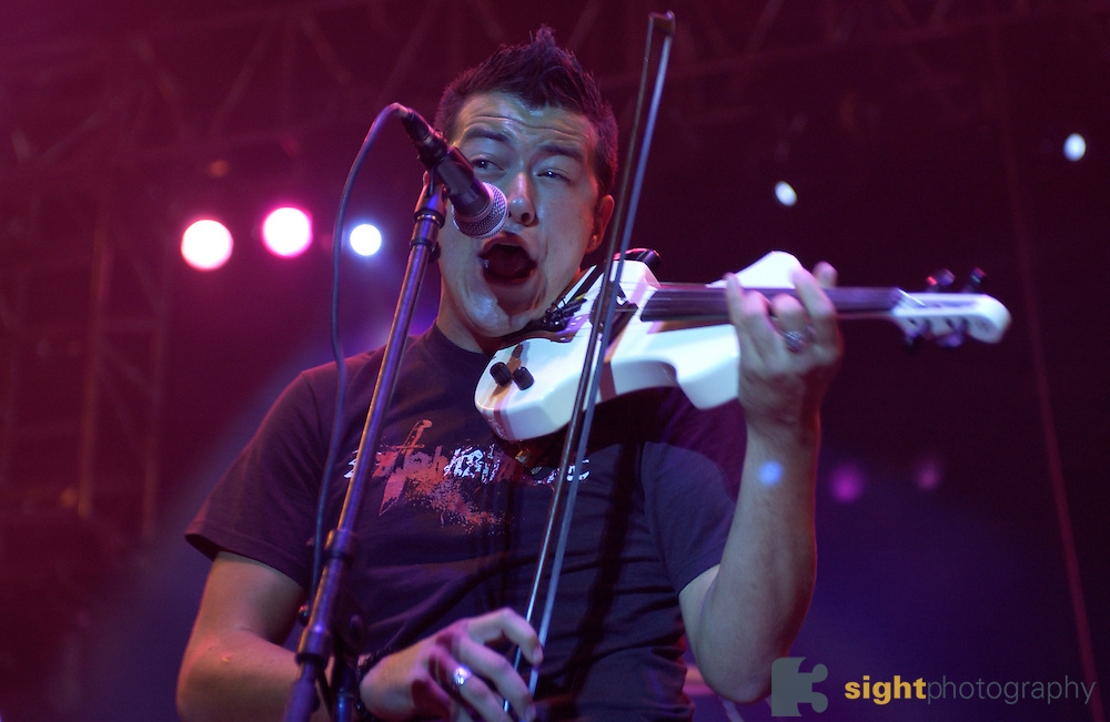 Sean Mackin ? violin, vocals of Yellow Card performing at the 2003 Gravity Games at the the North Coast Harbor behind the Rock and Roll Hall of Fame in Cleveland Ohio. Photo by Bryan Rinnert/3Sight Photography