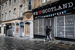 Edinburgh, Scotland, UK. 6 February 2021. The Old town of Edinburgh is almost deserted on a Saturday afternoon during national Covid-19 lockdown. All non essential shops including all tourist souvenir shops are closed as are restaurants and cafes. Pic; Tourist shops on Cockburn Street are closed . Iain Masterton/Alamy Live News