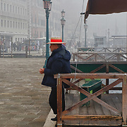 VENICE, ITALY - NOVEMBER 19: A gondolier waits for customers in St Mark's Square as thick fog shrouds the city, on November 19, 2011 in Venice, Italy. Venice woke up this morning under a heavy blanket of fog adding to the atmoshere of the city. HOW TO LICENCE THIS PICTURE: please contact us via e-mail at sales@xianpix.com or call our offices London   +44 (0)207 1939846 for prices and terms of copyright. First Use Only ,Editorial Use Only, All repros payable, No Archiving.© MARCO SECCHI