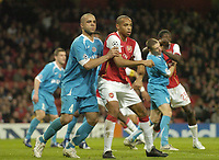 Photo: Olly Greenwood.<br />Arsenal v PSV Eindhoven. UEFA Champions League. Last 16, 2nd Leg. 07/03/2007. Arsenal's Thierry Henry is closey marked by PSV goalscorer Alex