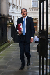 London, February 24th 2015. Ministers arrive at the weekly cabinet meeting at 10 Downing Street. PICTURED: Foreign Secretary Philip Hammond.