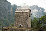 Kula (defensive tower house) in Theth, on the Peaks of the Balkans Trail, in northern Albania. Known as the Nicoll Kolçeku Kula, it dates from the 17th century. © Rudolf Abraham