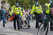 Police arrested an elderly woman in a wheelchair in Parliament Square, central London on Tuesday, Sept 1, 2020. Ten days of climate change demonstrations have begun as Extinction Rebellion (XR) take to the streets across the UK.  (VXP Photo/ Vudi Xhymshiti)