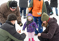 Julia Schilling keeps her eyes on her s'more during Saturday's Winterfest at Prescott Farm.   (Karen Bobotas/for the Laconia Daily Sun)