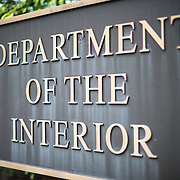 Sign for the US Department of the Interior for the headquarters on 18th St NW in Washington DC's Foggy Bottom district.
