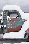 Vertical of snow-covered pickup truck