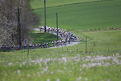 The peloton chases the break in the first lap of the Flèche Wallonne Femmes - a 137km road race from starting and finishing in Huy on April 20, 2016 in Liege, Belgium.