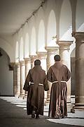 Monks walking in Interior del Convento de San Francisco - Quito, Ecuador, South America