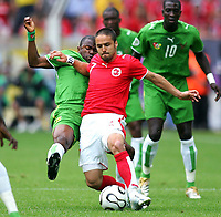 v.l. Kuami Agboh, Ricardo Cabanas Schweiz<br /> Fussball WM 2006 Togo - Schweiz <br /> Togo - Sveits<br /> Norway only