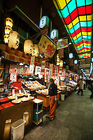 """Skyights over Nishiki Market -   a narrow shopping street made up of more than one hundred vendors.  Various kinds of fresh foods including many Kyoto specialties such as pickles and Japanese sweets, as well as fresh seafood and vegetables are sold.  Known as """"Kyoto's Kitchen"""" Nishiki Market's history goes back several centuries and many stores have been operated by the same families for generations."""
