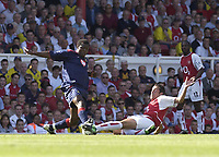 Picture: Henry Browne<br />Date: 13/09/2003<br />Arsenal v Portsmouth  FA Barclaycard Premiership<br /><br />Yakuba Aiyegbeni of Portsmouth beats Edu to the ball