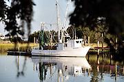 Shrimp boats along Jeremy Creek in the village of McClellanville, South Carolina.