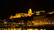 Eastern Europe, Hungary, Budapest, Royal Palace (Kiralyi palota) at night, The Danube River in the foreground