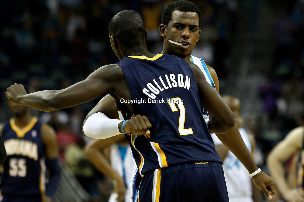 April 3, 2011; New Orleans, LA, USA; New Orleans Hornets point guard Chris Paul (3) and Indiana Pacers point guard Darren Collison (2) hug before a game at the New Orleans Arena.    Mandatory Credit: Derick E. Hingle