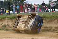 Hmm - this doesn't looks right - a competitor rolls during the race meeting at Smallfield Raceway, Surrey, UK on the 10th of July 2011 (photo by Andrew Tobin/SLIK images)