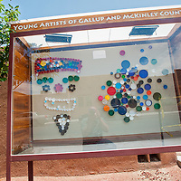 070513       Cable Hoover<br /> <br /> A bottle cap mosaic by Nelson Gonzalez is currently on display in the Young Artists of Gallup and McKinley County case in downtown Gallup.