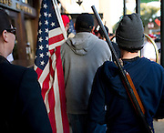 Demonstrators carry their weapons through the Fort Worth Stockyards during an open carry long rifle march demonstrating their 2nd amendment right to keep and bear arms on Thursday, January 31, 2013 in Fort Worth, Texas. (Cooper Neill/The Dallas Morning News)