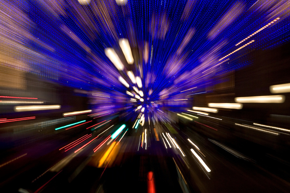 Blurred image of Christmas decorations and traffic in Regent Street, London, United Kingdom