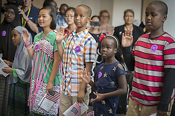 July 21, 2017 - St. Paul, MN, USA - Twenty-three children stood and took the Oath of Allegiance during a U.S. Citizenship and Immigration Services citizenship ceremony at the Minnesota Children's Museum, Friday, July 21, 2017 in St. Paul, Minn. (Credit Image: © Elizabeth Flores/TNS via ZUMA Wire)