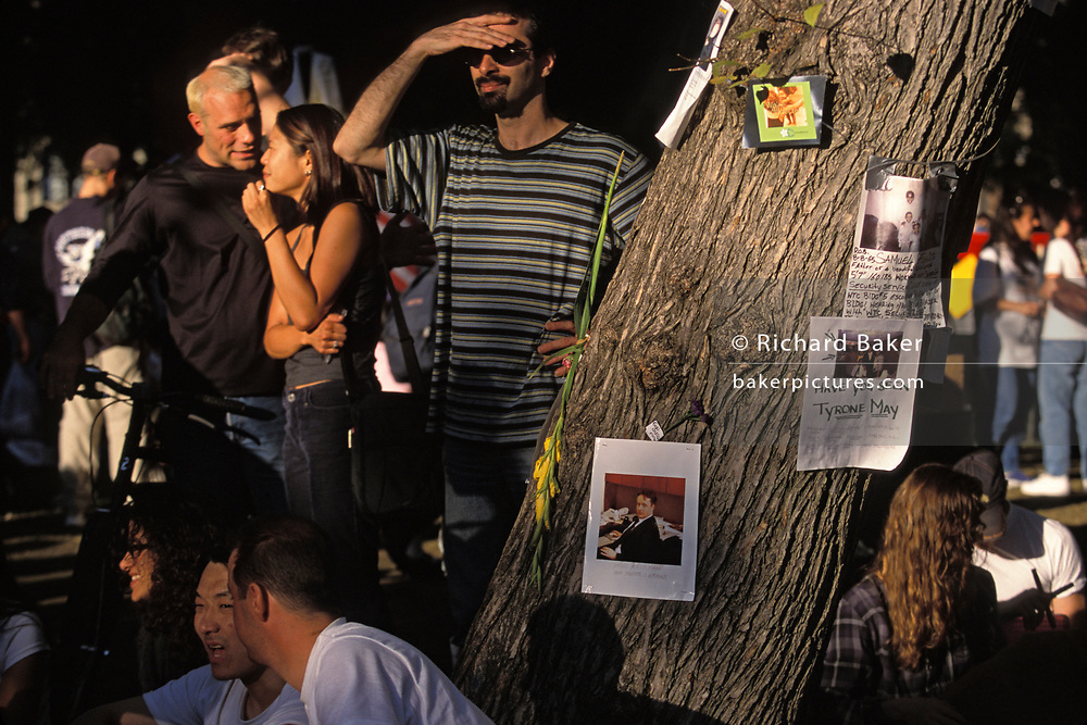 New Yorkers gather at the memorials in Union Square where photos are posted and appeals for missing friends and relatives, 10 days after the terrorist attacks on the World Trade Center and other sites in America on September 11th, on 19th September 2001, in New York, USA.