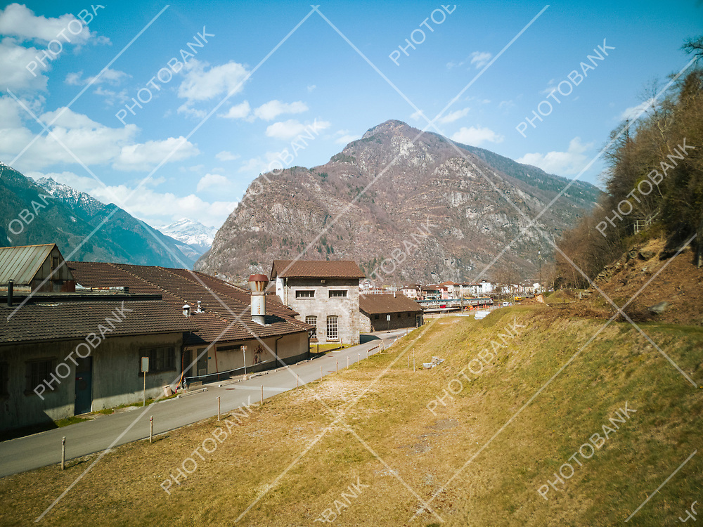 Abandoned factory front view in the valley. Glimpse of Biasca in Switzerland. Nobody inside