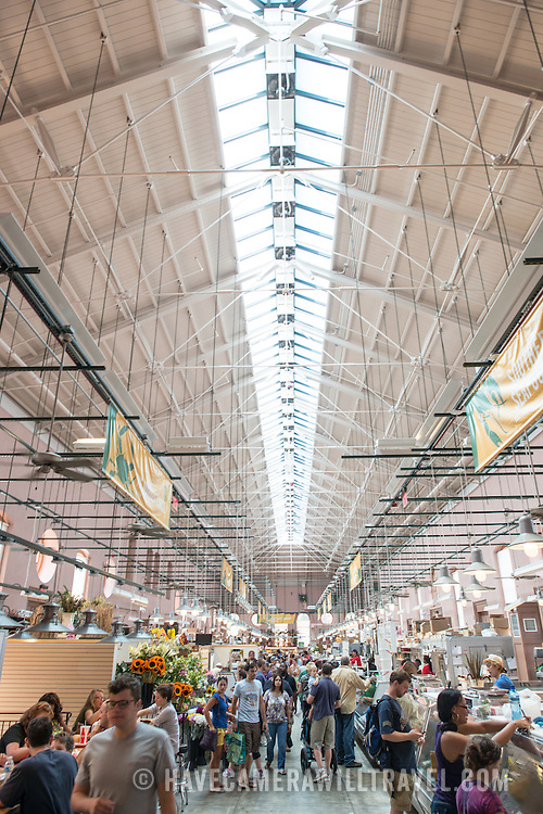 The main hall at Eastern Market, with the long skylight providing natural light. Eastern Market is an historic market on Capitol Hill in Washington DC. The original market building was badly damaged by fire in 2007, and the rebuilt building was reopened in 2009.