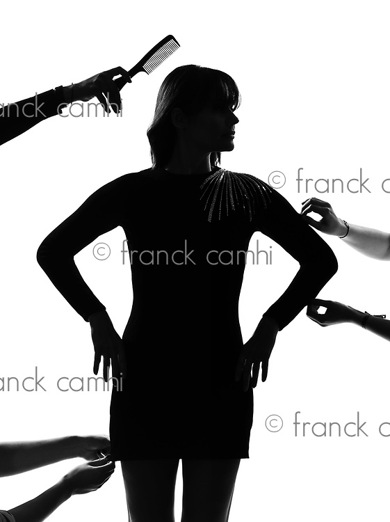 stylish sexy silhouette caucasian beautiful woman fashion model getting ready for photo session  on studio isolated white background