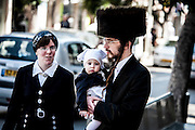 A Hassidic family in Purim costume Photographed in Bnei Brak, Israel