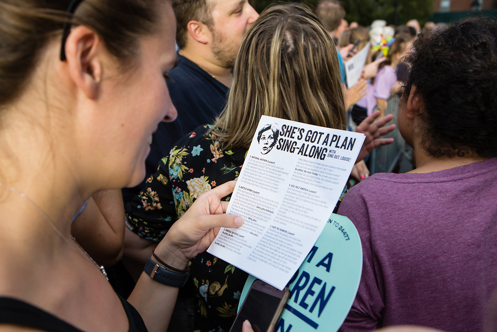 """New York, NY – 16 September 2019. Massachusetts Senator and Democratic Presidential candidate Elizabeth Warren drew a large and enthusiastic crowd at a speech for her increasingly popular 2020 presidential campaign in New York's Washington Square. Volunteerd handed out """"She's Got a Plan Sing-Along"""" sheets to the crowd."""