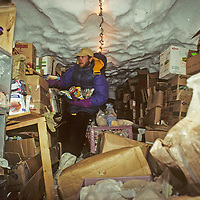 Michael Holmes, a cook at Patriot Hills expedition base near Antarctica's Ellsworth Mountains, collects meal ingredients from a huge snow cave that is used as a freezer.