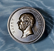 Henry Bessemer (1813-1898) English engineer and inventor.  A prolific inventor, he is best known for  the invention of a method of converting pig iron into steel (the Bessemer process) which made the cheap production of steel in bulk possible for the first time. Obverse of a commemorative medal.