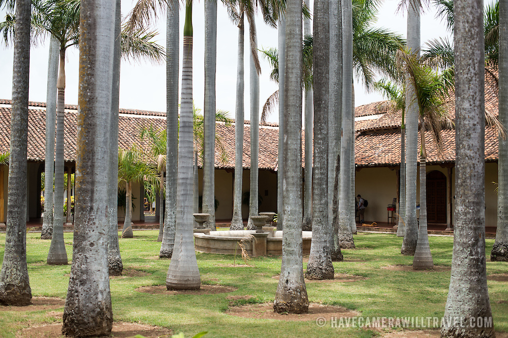 The main interior courtyard, filled with palm trees, of the Centro Cultural Convento San Francisco. The The Centro Cultural Convento San Francisco, located just a couple of blocks from Parque Central in Granada, is dedicated to the history of the region.