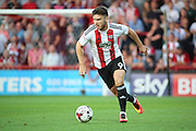 Brentford forward Scott Hogan (9)  dribbling during the EFL Sky Bet Championship match between Brentford and Nottingham Forest at Griffin Park, London, England on 16 August 2016. Photo by Matthew Redman.