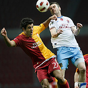 Galatasaray's Juan Emmanuel CULIO (L) and Trabzonspor's Piotr BROZEK (R) during their Turkish superleague soccer derby match Galatasaray between Trabzonspor at the TT Arena in Istanbul Turkey on Sunday, 10 April 2011. Photo by TURKPIX