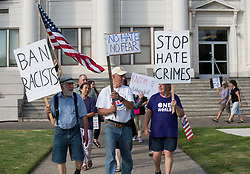 August 14, 2017 - Roseburg, Oregon, U.S - Demonstrators march outside the Douglas County Courthouse in Roseburg in solidarity with Charlottesville, VA and against hate. About 75 people marched, chanted, and sang songs during the protest in the small town on Monday. (Credit Image: © Robin Loznak via ZUMA Wire)
