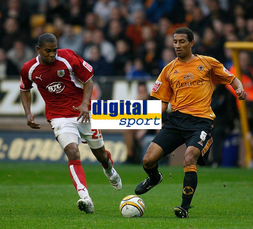 Photo: Steve Bond/Sportsbeat Images.<br />Wolverhampton Wanderers v Bristol City. Coca Cola Championship. 03/11/2007. Karl Henry (R) lays the ball off as Marvin Elliott (L) closes in