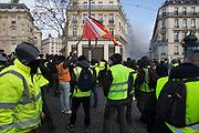 December, 8th, 2018 - Paris, Ile-de-France, France: Demonstrators protest on Champs Elysees. The French 'Gilets Jaunes' demonstrate a fourth day. Their movement was born against French President Macron's high fuel increases. They have been joined en mass by students and trade unionists unhappy with Macron's policies. Nigel Dickinson
